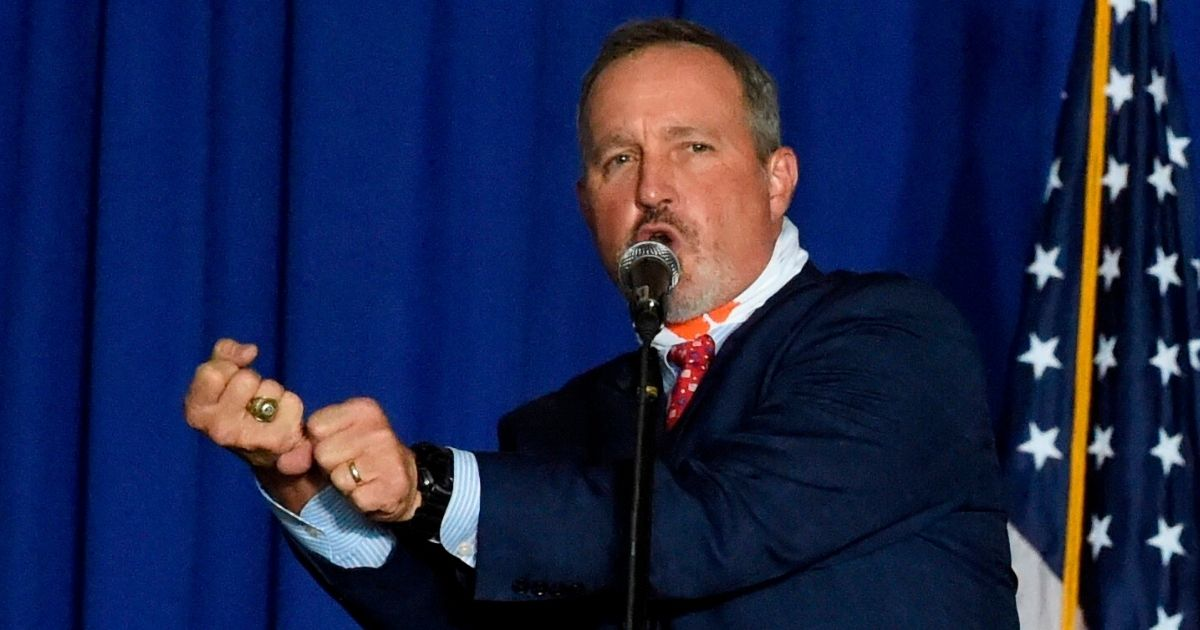 """Republican Rep. Jeff Duncan of South Carolina gestures as he refers to President Donald Trump's """"home run"""" in the Supreme Court confirmation of Justice Amy Coney Barrett during a campaign rally Oct. 27 in Greenville, South Carolina."""