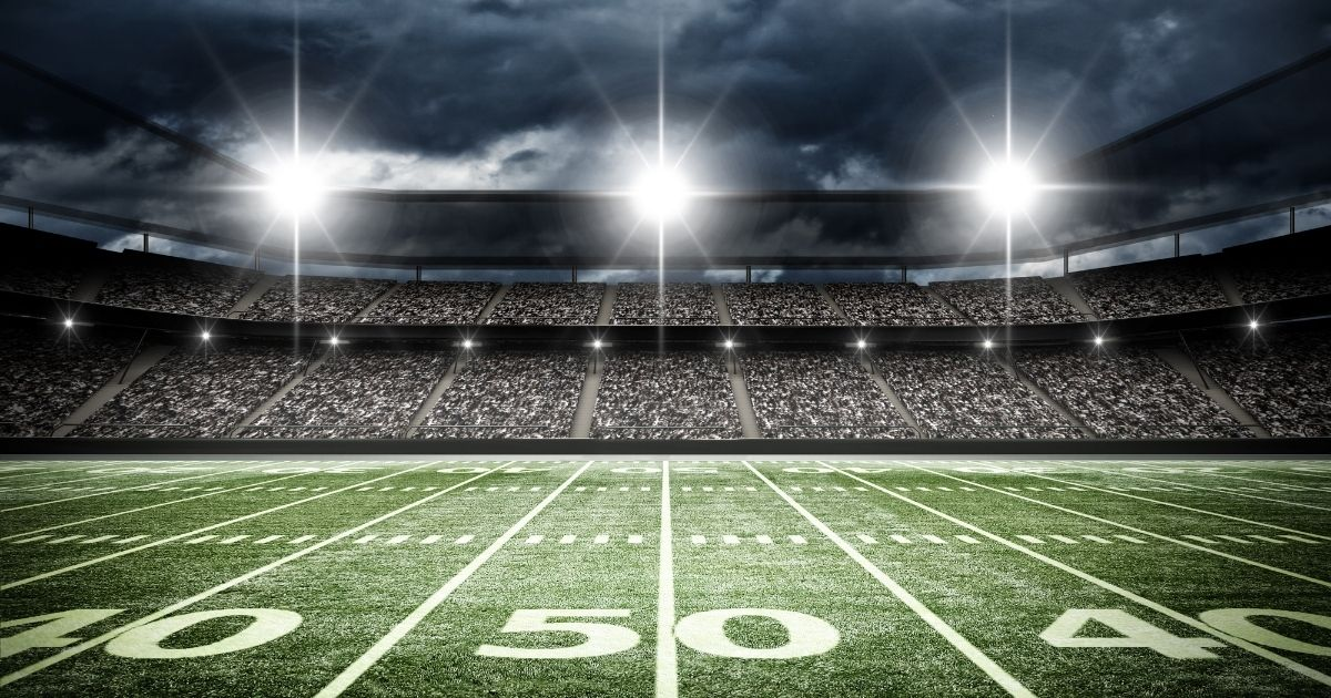 An American football stadium is pictured at night in the stock image above.