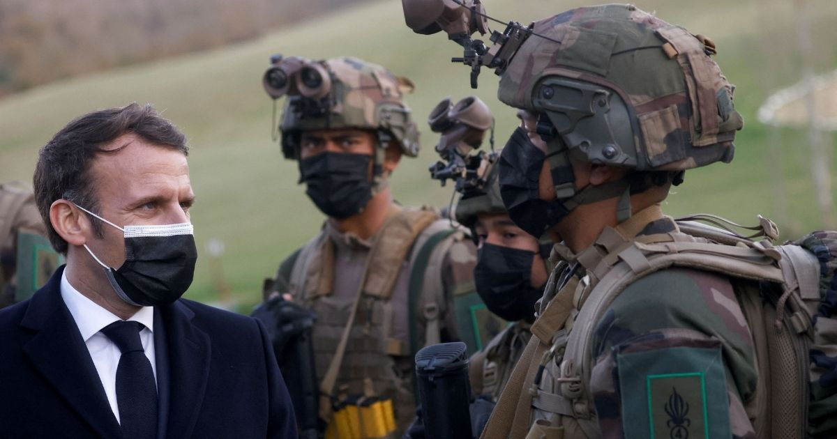 French President Emmanuel Macron, left, speaks with a soldier during a visit to the training centre of the 4th Regiment of the French Foreign Legion, in Saint-Gauderic, southern France, on March 12, 2021.