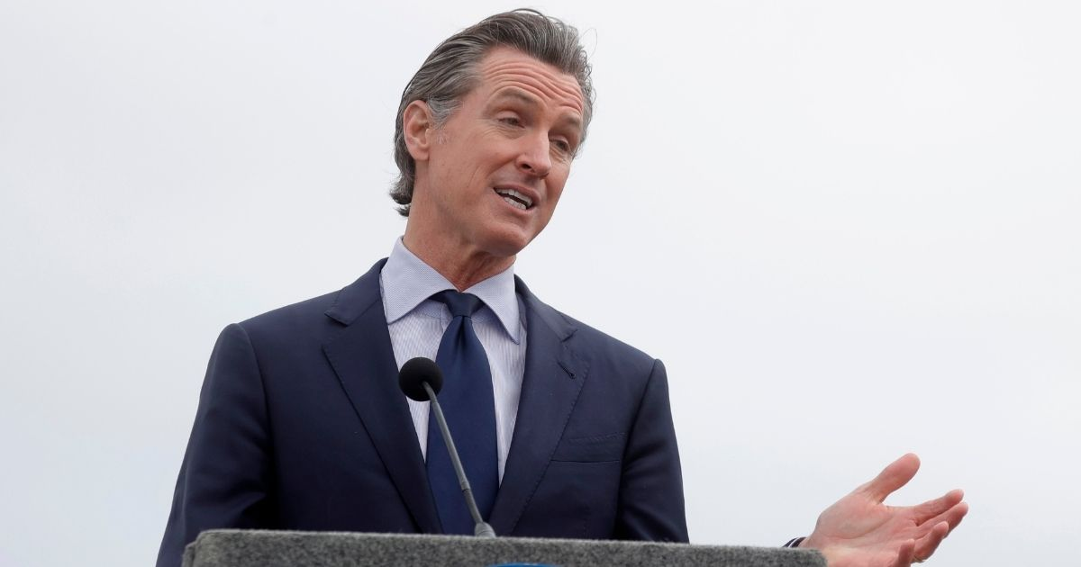 California Gov. Gavin Newsom speaks during a news conference after touring the vaccination clinic at City College of San Francisco on April 6.