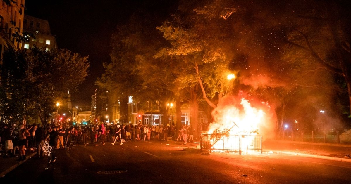 Protesters set a fire in the street a block from the White House while protesting the death of George Floyd in Washington, D.C., on May 31, 2020.