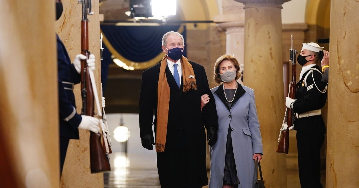 Former President George W. Bush and Laura Bush arrive in the Crypt of the U.S. Capitol for President-elect Joe Biden's inauguration ceremony to be the 46th President of the United States on Jan. 20 in Washington, D.C.