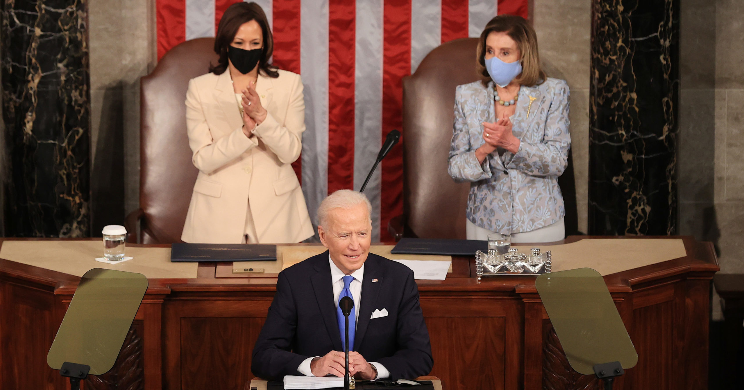 President Joe Biden addresses a joint session of Congress as Vice President Kamala Harris, left, and Democratic Speaker of the House Nancy Pelosi, right, look on in the House chamber of the U.S. Capitol on Wednesday in Washington, D.C.