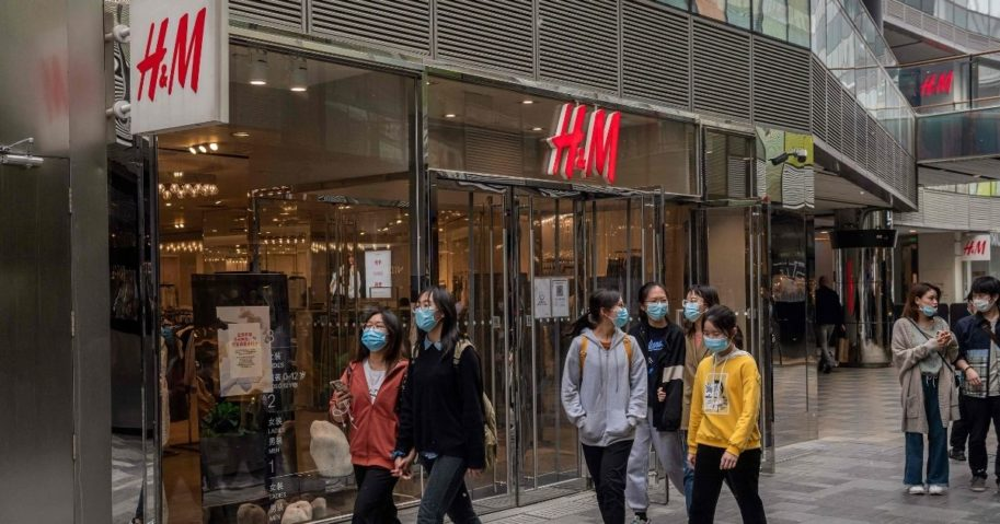 People walk past an H&M store in Beijing on Monday.