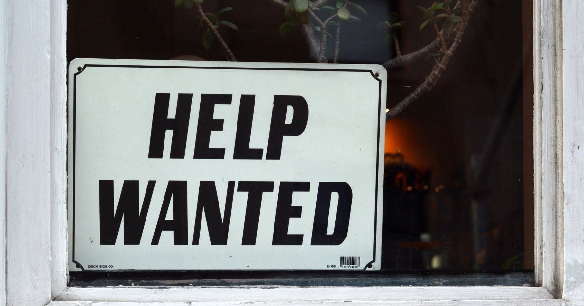 The above stock photo shows a'Help Wanted' sign in a shop window in SanFrancisco.