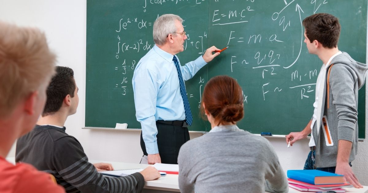 A high school math teacher is pictured in the stock image above.