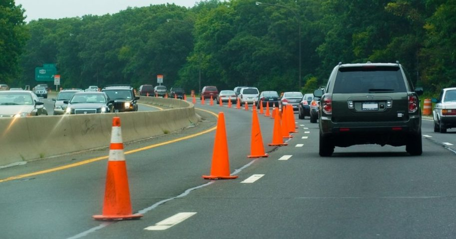 The above stock image shows roadwork on the highway.