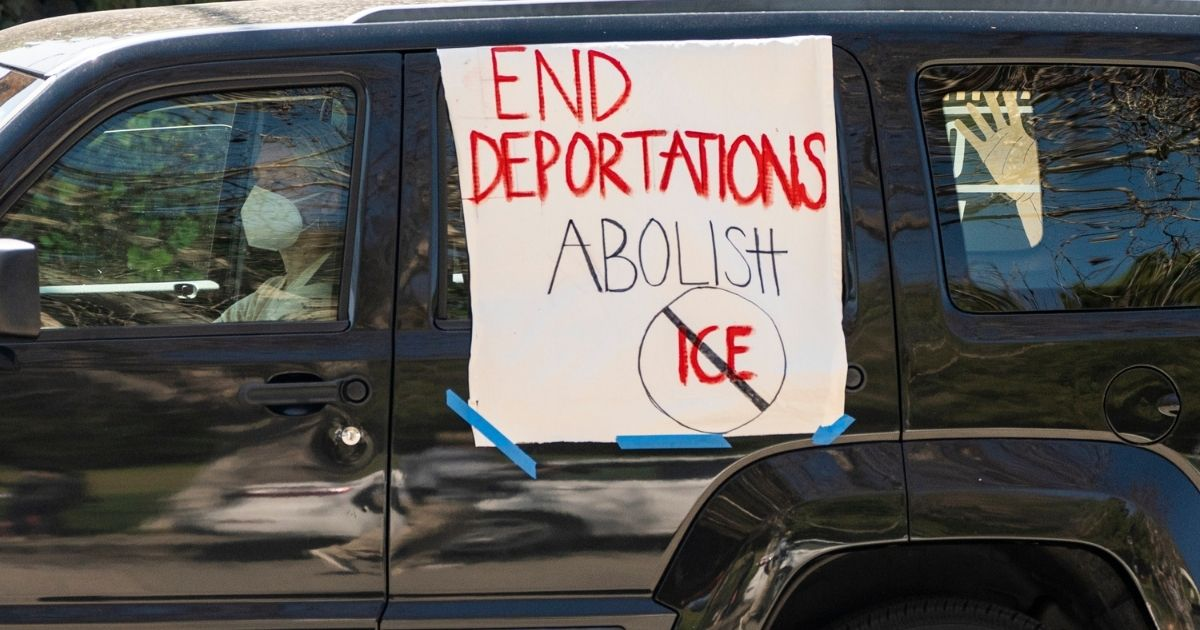 """Motorists cruise around the Silver Lake Reservoir in a """"Reunite Our Families Now!'' rally to protest deportations in Los Angeles on March 6, 2021."""