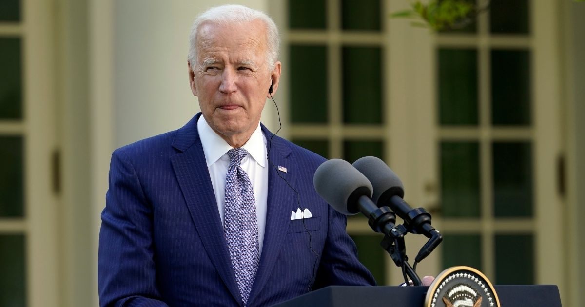 President Joe Biden listens as Japanese Prime Minister Yoshihide Suga speaks at a news conference in the Rose Garden of the White House on Friday in Washington.