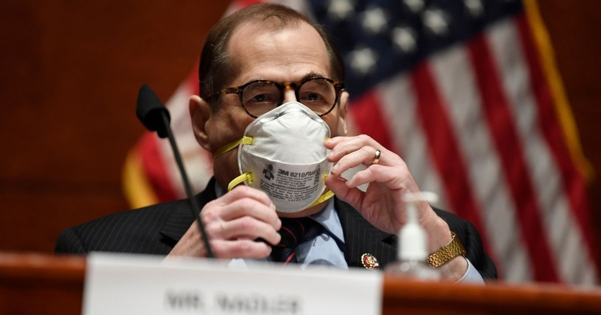 House Judiciary Committee Chairman Rep. Jerrold Nadler adjusts his face mask during a hearing on Capitol Hill, June 24, 2020, in Washington, D.C