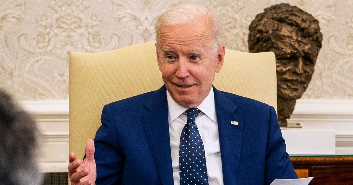 President Joe Biden conducts a meeting in the Oval Office at the White House on Thursday in Washington, D.C.