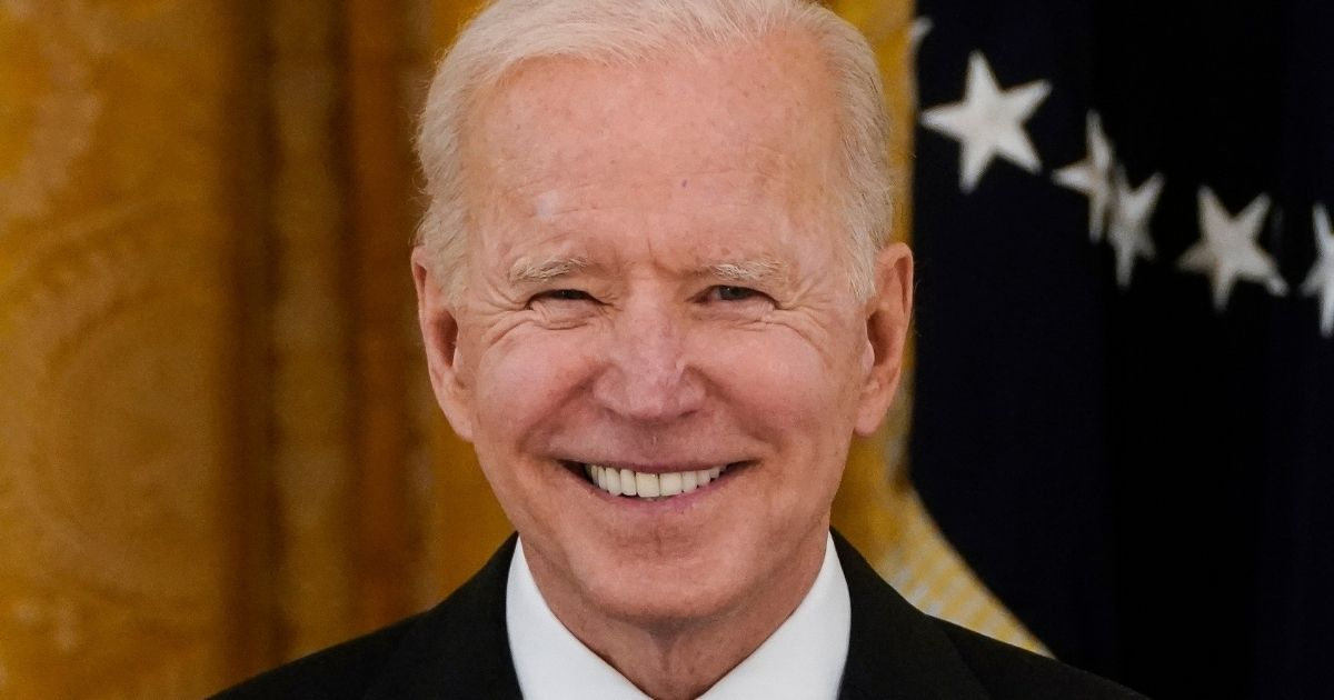 President Joe Biden smiles during a Cabinet meeting in the East Room of the White House in Washington on April 1.