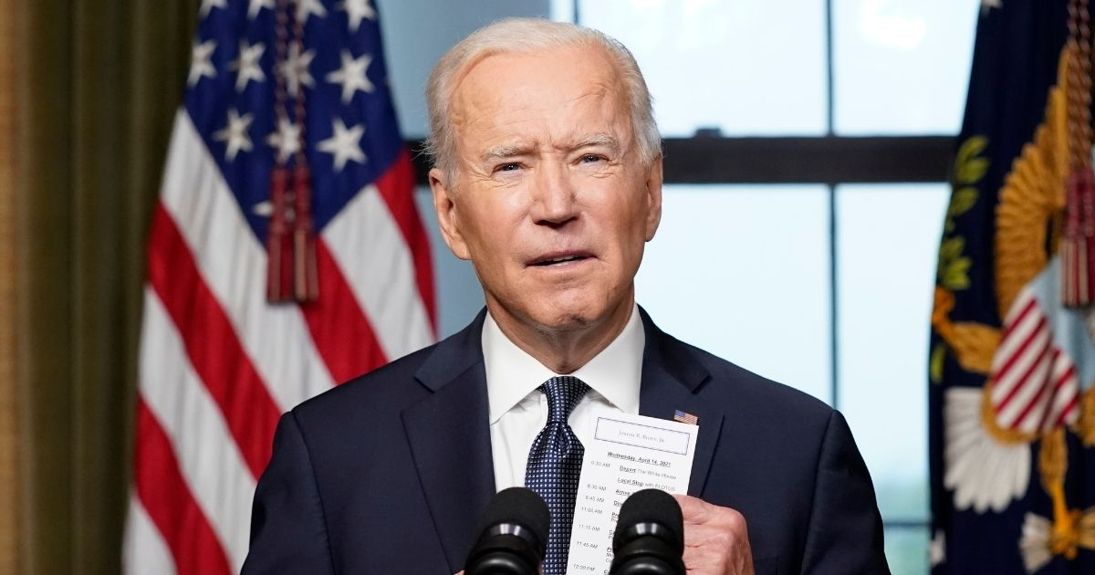 President Joe Biden pulls a notecard from his pocket as he speaks from the Treaty Room in the White House about the withdrawal of U.S. troops from Afghanistan on April 14, 2021, in Washington, D.C.