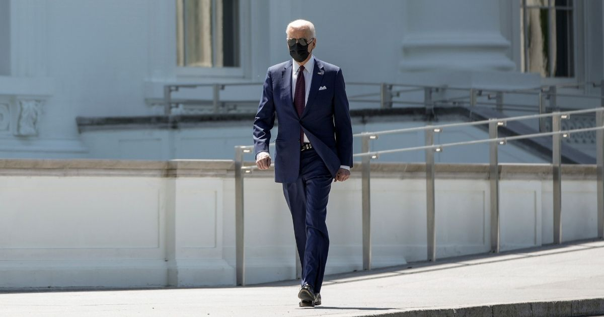 President Joe Biden arrives to speak about updated CDC mask guidance on the North Lawn of the White House on Tuesday in Washington, D.C.