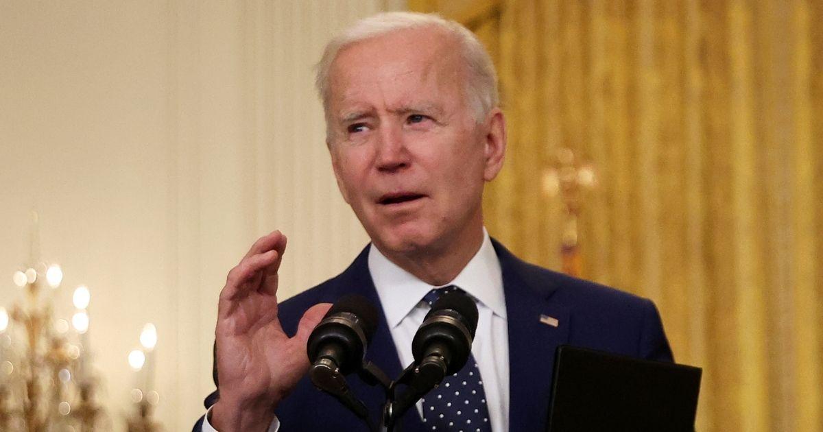 President Joe Biden speaks in the East Room of the White House in Washington on Thursday.