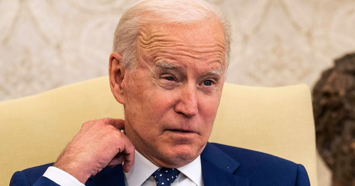 President Joe Biden meets with members of the Congressional Asian Pacific American Caucus Executive Committee in the Oval Office of the White House in Washington on Thursday.