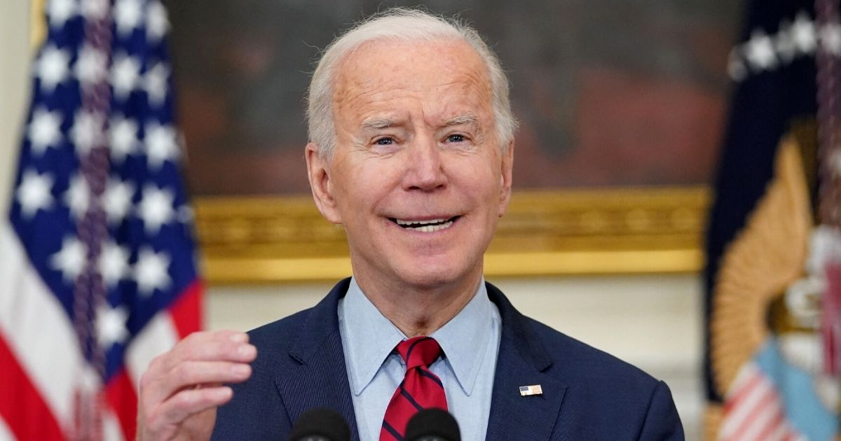 President Joe Biden speaks in the State Dining Room of the White House in Washington on March 23.