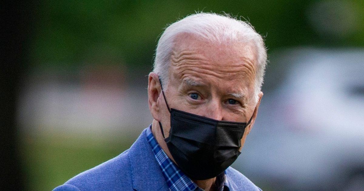 President Joe Biden walks on the Ellipse near the White House on Sunday in Washington, D.C.