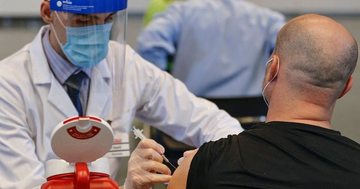 A man receives the Johnson & Johnson coronavirus vaccine at the International Union of Operating Engineers Local 399 union hall vaccination site in Chicago on April 6.