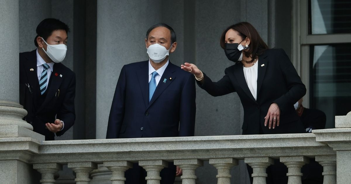 Vice President Kamala Harris and Japanese Prime Minister Yoshihide Suga look at the White House from a balcony of the Eisenhower Executive Office Building on April 16 in Washington, D.C.