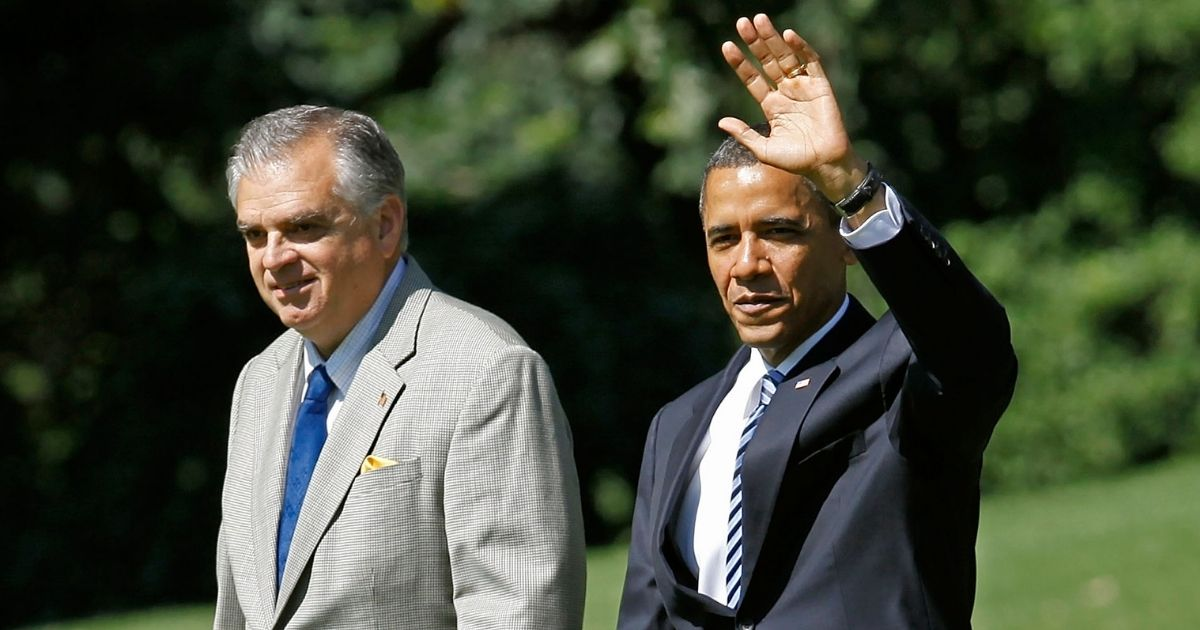 Ray LaHood, who was transportation secretary at the time, walks with then-President Barack Obama across the South Lawn of the White House in Washington before departing aboard Marine One on June 18, 2010.