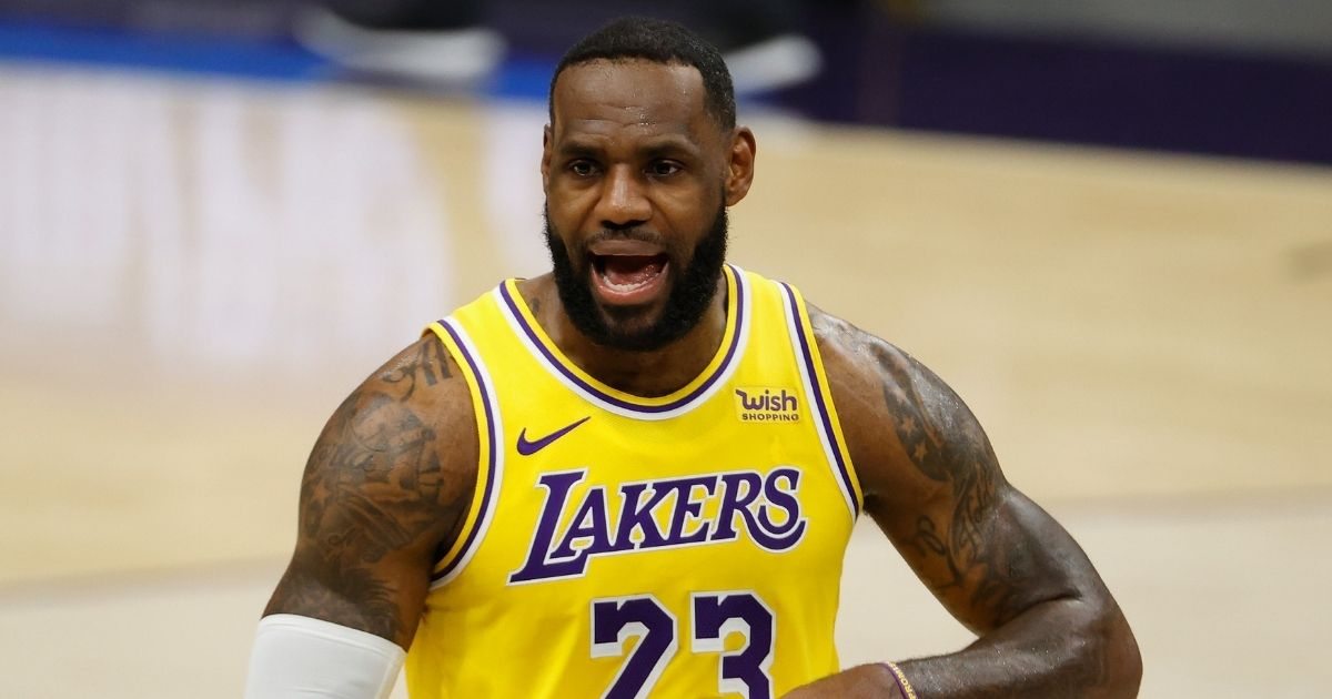 LeBron James of the Los Angeles Lakers reacts during the second half of the NBA preseason game against the Phoenix Suns at Talking Stick Resort Arena on Dec. 18, 2020, in Phoenix.