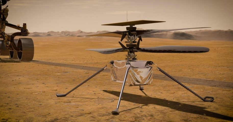 In this concept illustration provided by NASA, NASA's Ingenuity Mars Helicopter stands on the Red Planet's surface as NASA's Mars 2020 Perseverance rover (partially visible on the left) rolls away.