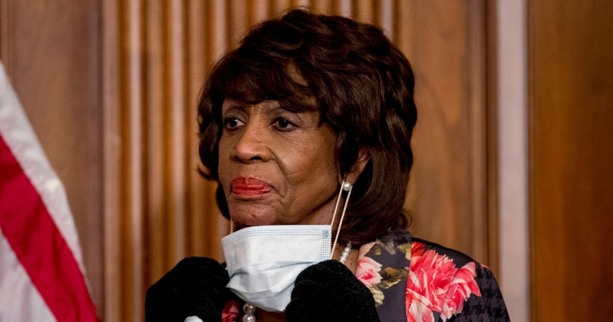 House Financial Services Committee Chairwoman Maxine Waters takes her mask off to speak during a signing ceremony for the Paycheck Protection Program and Health Care Enhancement Act on Friday.