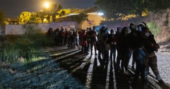 Central American immigrants wait to be processed by U.S. Border Patrol agents after they illegally crossed the Rio Grande from Mexico into Roma, Texas, early on April 10.