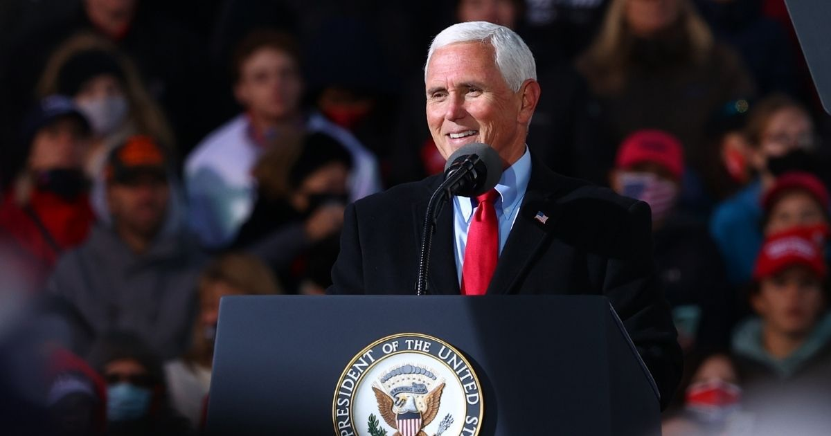 Former Vice President Mike Pence speaks at a rally on Nov. 2, 2020, in Traverse City, Michigan.