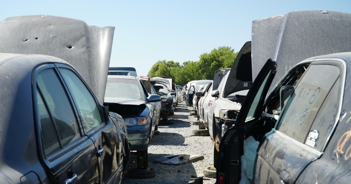 Cars are lined up in a wrecking yard waiting to be stripped of usable spare parts in San Jose, California, on June 29.