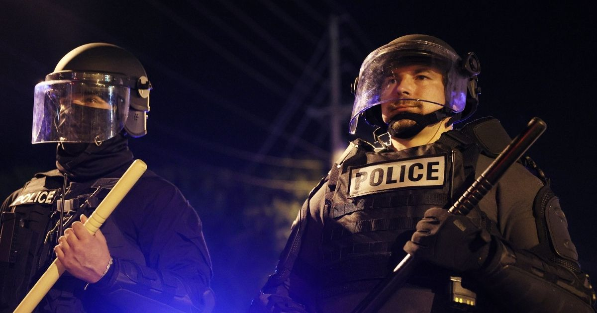 Police in riot gear force people off a street as they protest the killing of Andrew Brown Jr. on Tuesday in Elizabeth City, North Carolina.