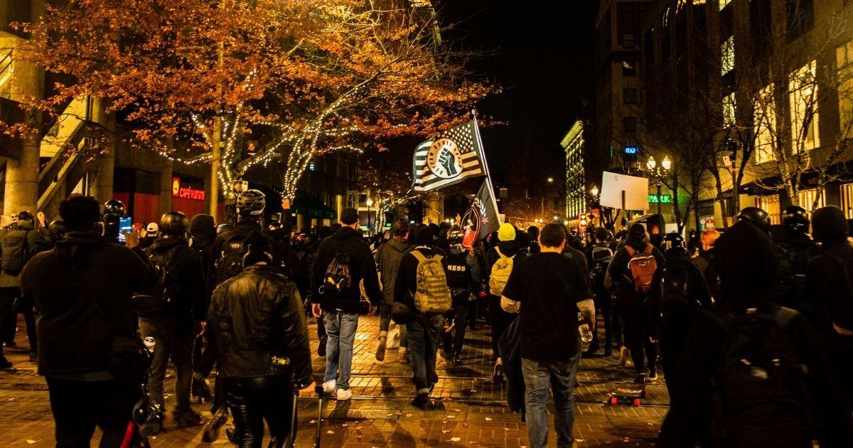 """Protesters march in Portland, Oregon, on Nov. 4, 2020, during a Black Lives Matter"""" demonstration."""