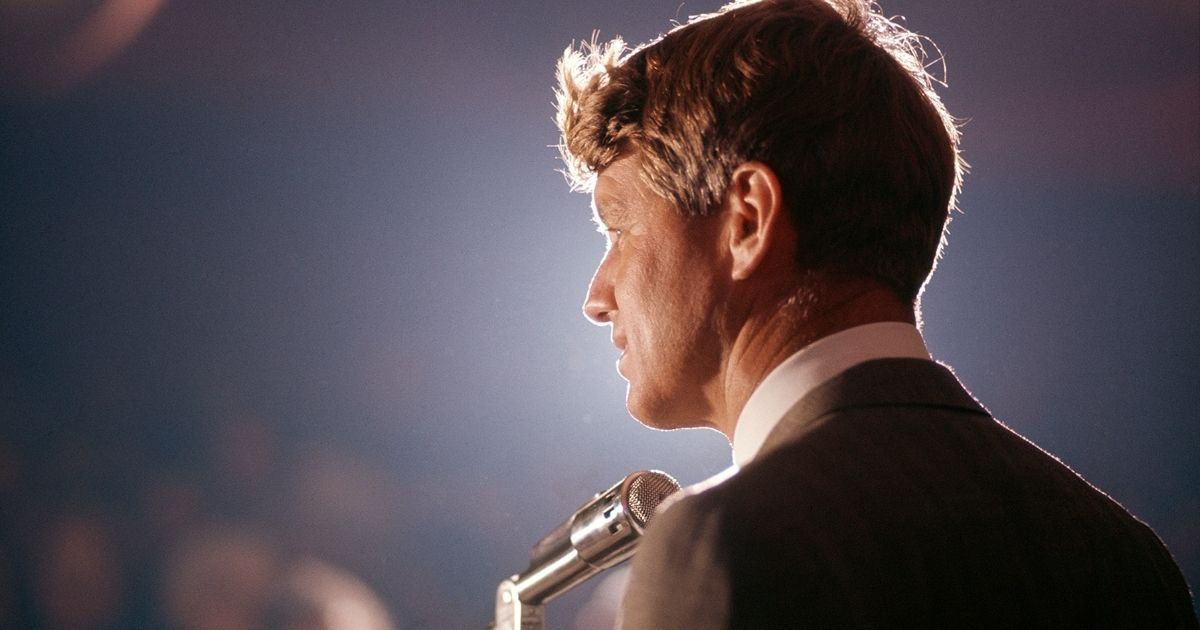 Robert F. Kennedy speaks into a microphone at an unspecified rally during his campaign for the Democratic Party's presidential nomination in 1968.