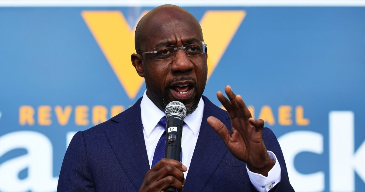 Raphael Warnock, then a Georgia Senate candidate, speaks at his Labor Canvass Launch at IBEW Local 613 on Jan. 5, 2021, in Marietta, Georgia.