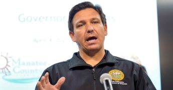 Florida Gov. Ron DeSantis gestures during a news conference April 4, 2021, at the Manatee County Emergency Management office in Palmetto, Florida.