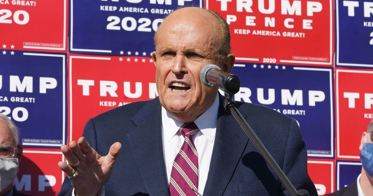 Rudy Giuliani speaks at a news conference in the parking lot of a landscaping company on Nov. 7, 2020, in Philadelphia.