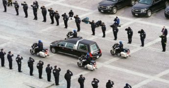 A hearse leaves with the cremated remains of Capitol Police Officer Brian Sicknick after he lay in honor at the U.S. Capitol in Washington on Feb. 3.