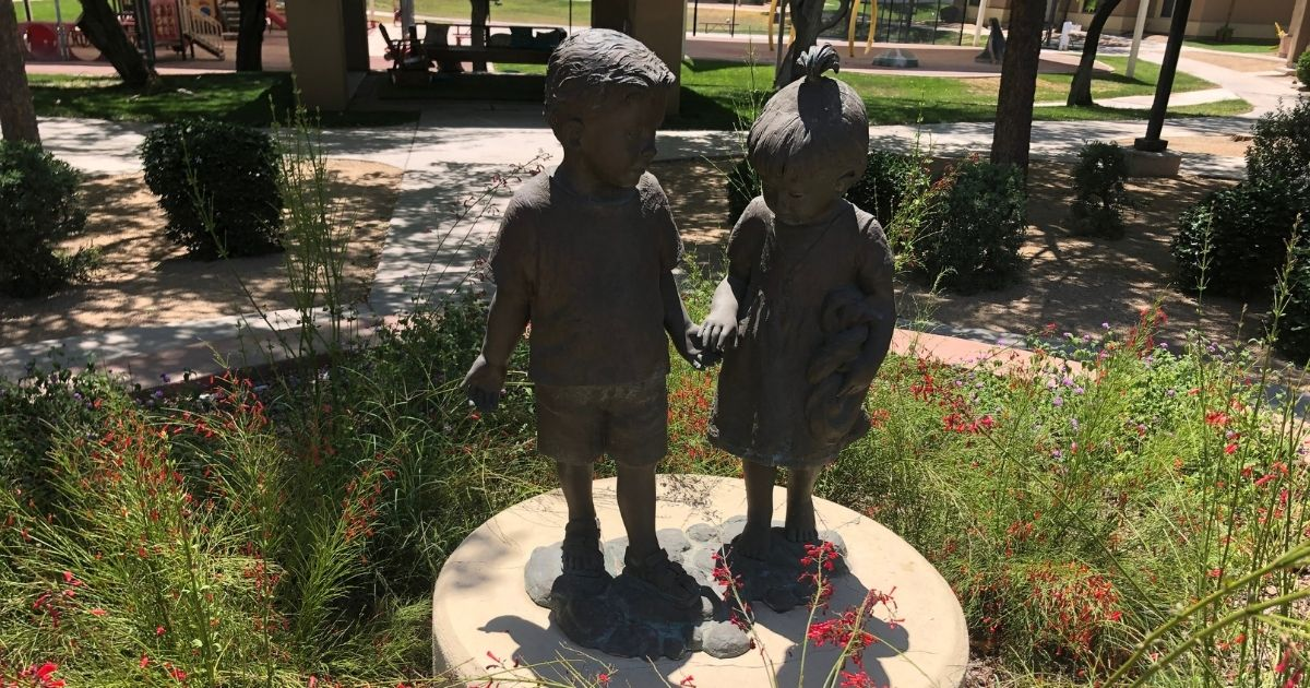 A statue of children holding hands is seen at the StreetLightUSA shelter in the Phoenix area.