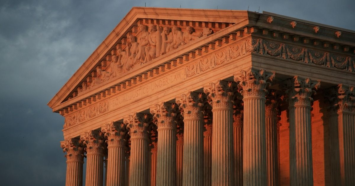 The U.S. Supreme Court is seen at sunset in Washington, D.C.