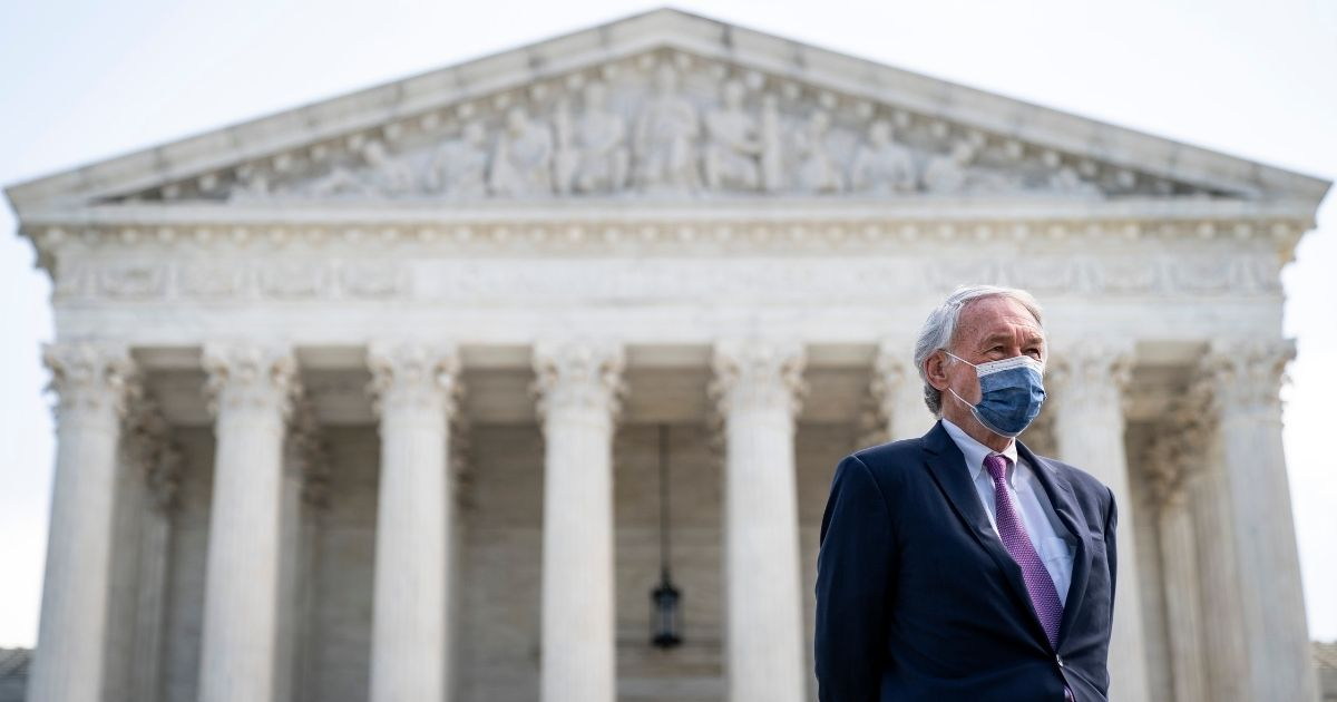 Democratic Sen. Ed Markey of Massachusetts attends a news conference in front of the U.S. Supreme Court to announce legislation to pack the court on Thursday in Washington, D.C.