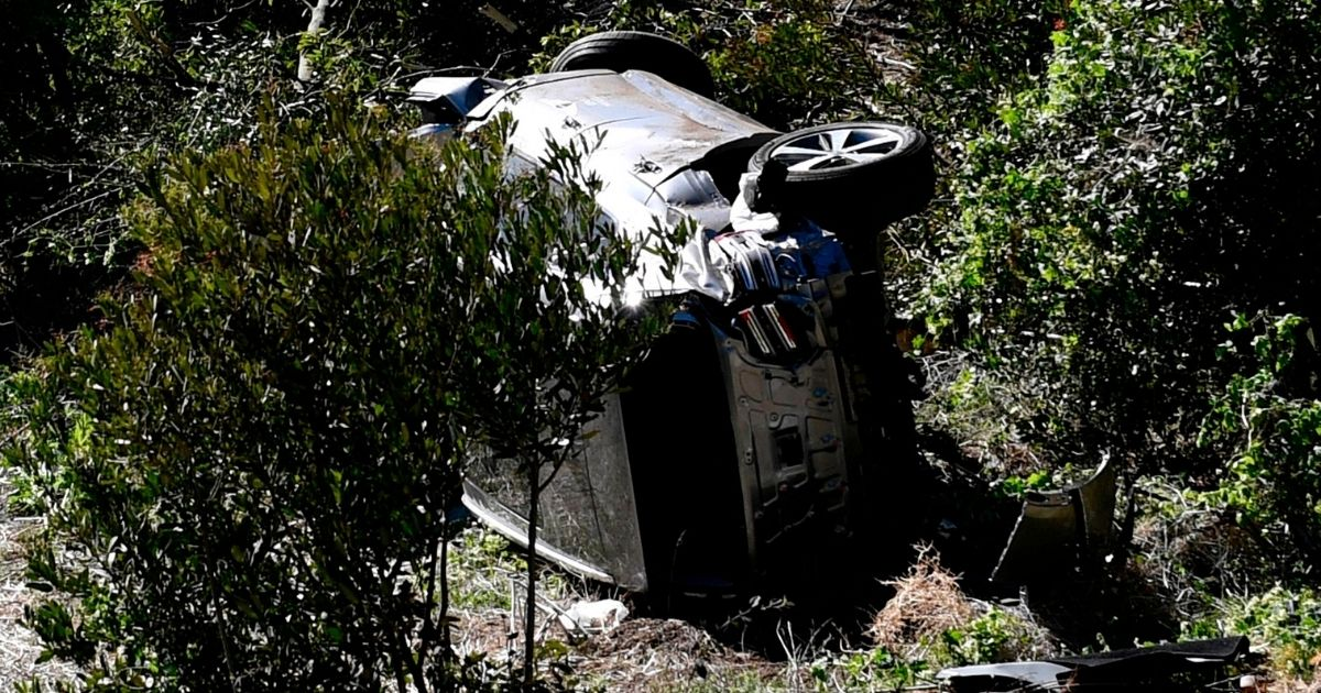 The vehicle driven by golfer Tiger Woods lies on its side in Rancho Palos Verdes, California, on Feb. 23, 2021, after a rollover accident.