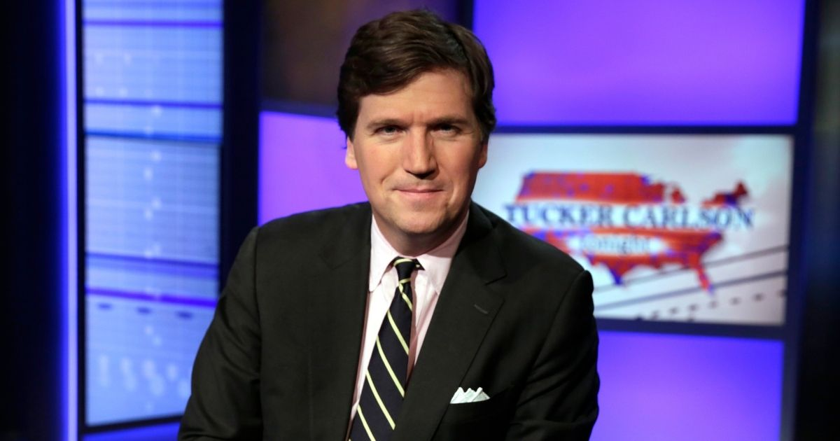 Tucker Carlson poses for a photo in a Fox News studio in New York City on March 2, 2017.