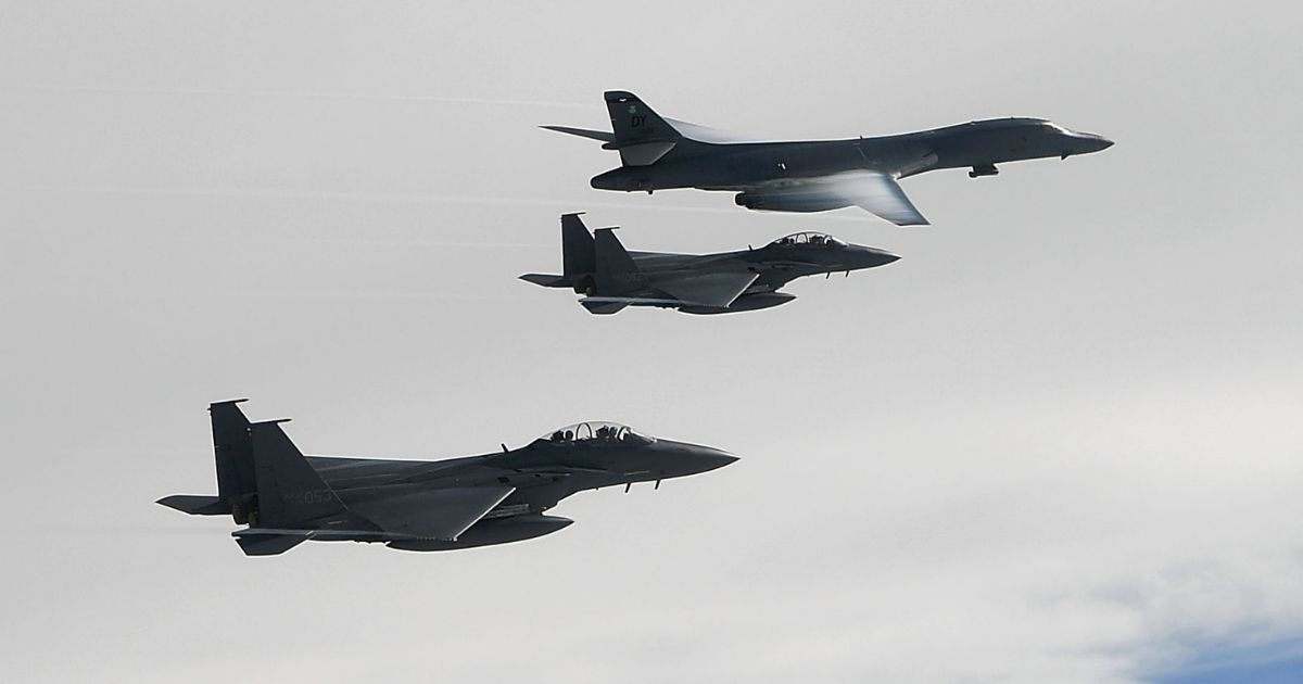In this handout photo released by the South Korean Defense Ministry, a U.S. Air Force B-1B Lancer bomber (top) flies with South Korean jets over the Korean Peninsula during a South Korea-U.S. joint live fire drill on July 8, 2017, in Korean Peninsula, South Korea.
