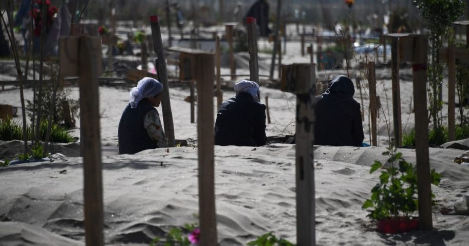 This photo taken on May 31, 2019, shows Uighur women praying in a graveyard on the outskirts of Hotan in China's northwest Xinjiang region.
