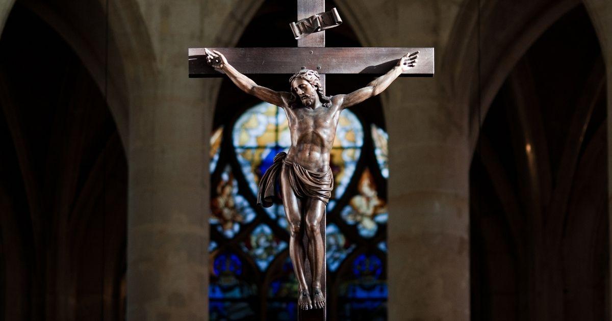 A statue of Jesus Christ on the cross at Saint-Étienne-du-Mont church in Paris.