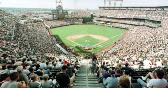 Fans filling the seats of Coors Field in a 1998 file photo.