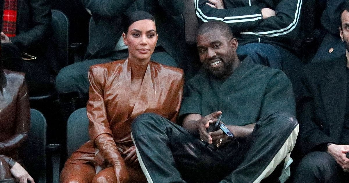 Kim Kardashian West and her husband, Kanye West, attend a fashion show in Paris on March 1, 2020.