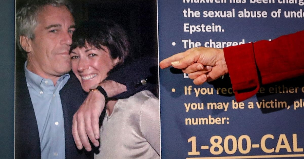 Audrey Strauss, acting U.S. attorney for the Southern District of New York, points to a photo of Jeffrey Epstein and Ghislaine Maxwell during a news conference in New York City on July 2, 2020. Epstein, who died the previous year, and Maxwell have been accused in several sex trafficking criminal cases and civil lawsuits.