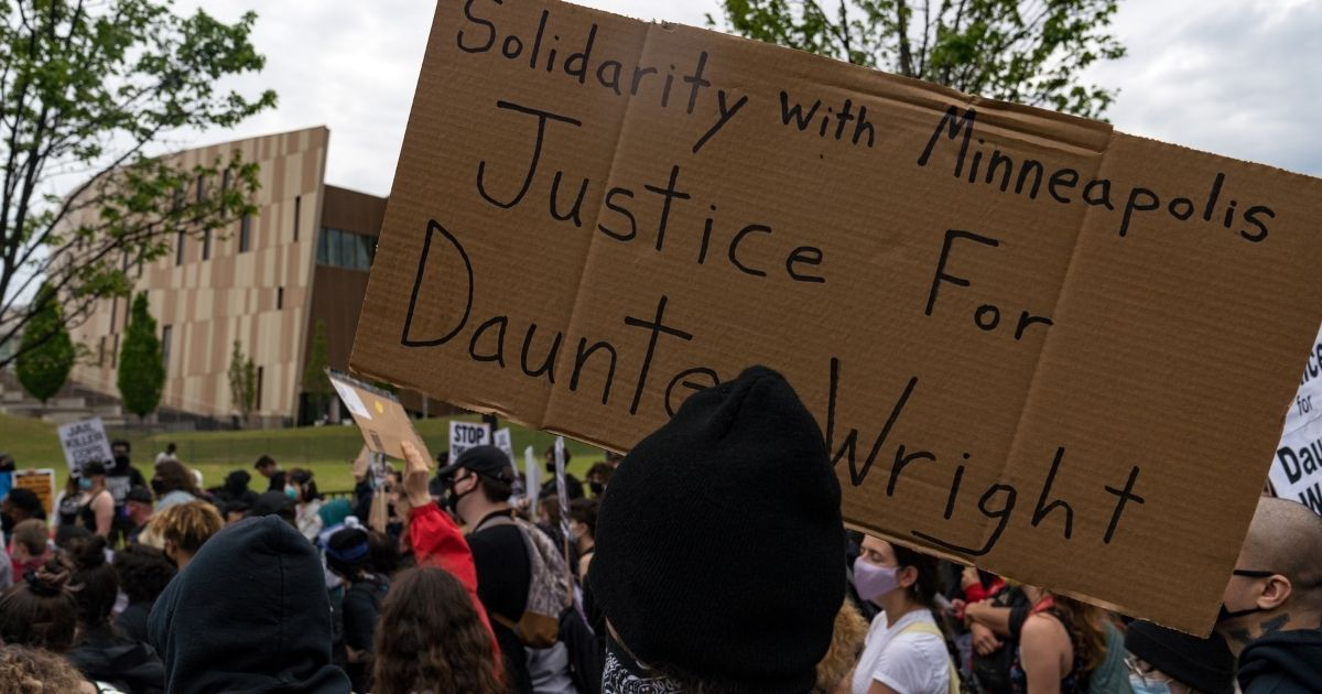 Demonstrators in Atlanta march to the National Center for Civil and Human Rights on April 14, 2021, while protesting the shooting death of Daunte Wright. Wright, a black man who had been pulled over for a traffic stop near Minneapolis on April 11, was shot and killed by an officer who police say mistook her gun for a Taser.